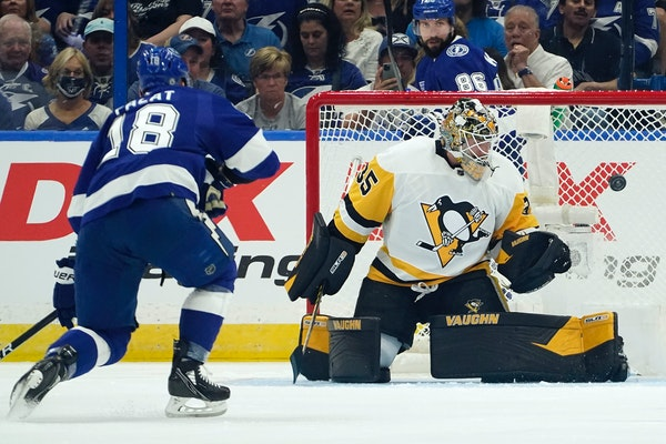 Penguins goaltender Tristan Jarry made a save on Lightning left winger Ondrej Palat during the first period Tuesday. Jarry made 26 stops in Pittsburgh