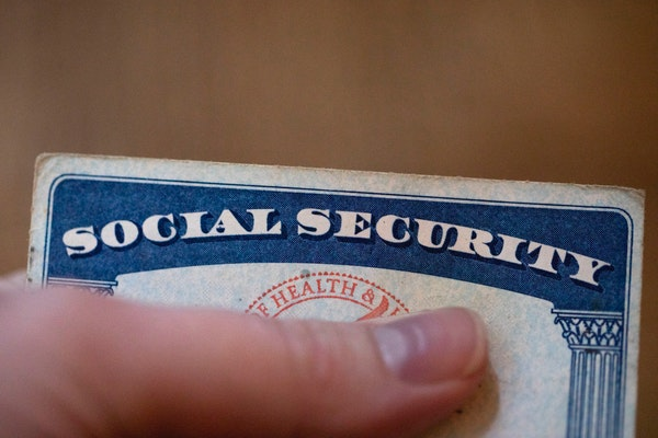 This Tuesday, Oct. 12, 2021, photo shows a Social Security card in Tigard, Ore. Millions of retirees on Social Security will get a 5.9% boost in benef