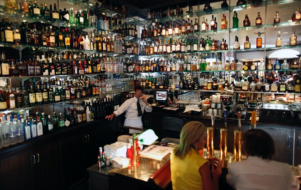 The bar at the St. Paul Grill features an extensive selection of liquor.