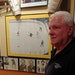At Tom Reid's Hockey City Pub in St. Paul, the owner and former North Stars defenseman stood next to a picture of him scoring an unlikely penalty-sh
