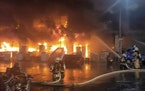 In this image taken from video by Taiwan's EBC, firefighters battle a blaze at a building in Kaohsiung, in southern Taiwan on Thursday, Oct. 14, 202