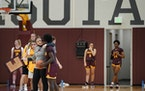 Gophers coach Lindsay Whalen gave instruction to guard Alexia Smith (1) during Thursday's practice at the Athletes Village.