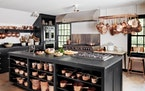 Martha stores her copper pots and pans on an overhead rack near the stoves, where they are always easy to reach.