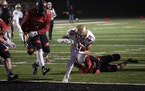Lakeville South's Carson Hansen ran into the endzone for in the first quarter.