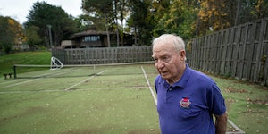Robert Tengdin walked on his backyard tennis court, which has been covered by high stormwater. He's suing the City of Edina over the matter.