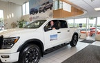 A Nissan Titan is displayed for sale at Bill Korum's dealership in Pullayup, Wash. Amid a shortage of new cars, many buyers have been forced to kick