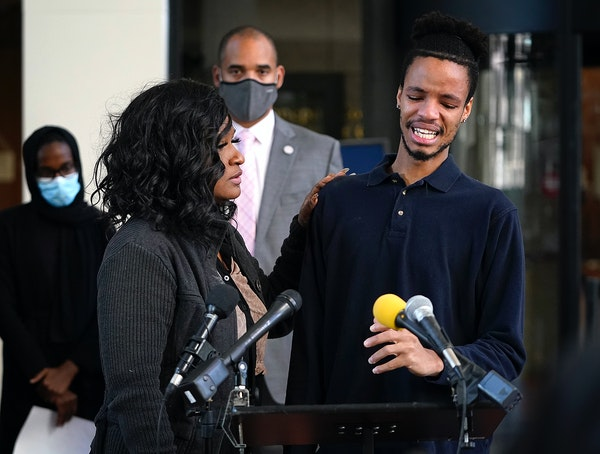 Winston Smith's brother, Kidale Smith, became emotional at a news conference in Minneapolis on Friday. He was comforted by Toshira Garraway Allen of