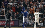 Drama makes playoff baseball more fun. Thursday night, the Giants' Wilmer Flores, right, reacted after he was called out on strikes as Dodgers catch