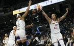Chicago Sky's Kahleah Copper goes up to shoot against Phoenix Mercury's Brittney Griner (42) and Kia Vaughn (1) during the first half