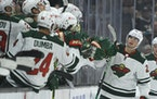 Wild left wing Kevin Fiala is congratulated by the bench after scoring a goal against the Anaheim Ducks during the second period