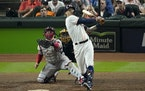Houston Astros' Carlos Correa hits a home run against the Boston Red Sox during the seventh inning in Game 1