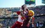 Minnesota Golden Gophers wide receiver Chris Autman-Bell (7) caught the third touchdown of the game in the second quarter as he was defended by Nebras