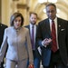 """House Speaker Nancy Pelosi walks with Rep. Emanuel Cleaver, who worries Republicans will use the """"defund the police"""" slogan to attack Democrats in"""