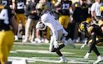 Purdue wide receiver David Bell runs from Iowa defensive back Matt Hankins during the first half Saturday