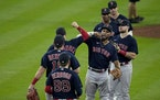The Boston Red Sox celebrate after their win against the Houston Astros in Game 2