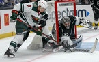 Los Angeles Kings goalie Jonathan Quick blocks a shot by Wild forward Nico Sturm during the second period.