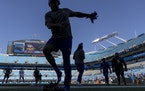 Vikings players warm up in Charlotte.