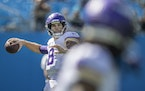 Vikings quarterback Kirk Cousins warms up before the game.