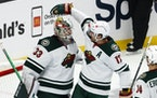 Wild goalie Cam Talbot and teammate Marcus Foligno celebrated the team's 3-2 win over the Los Angeles Kings on Saturday.
