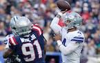 Cowboys quarterback Dak Prescott, right.