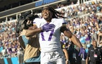 Minnesota Vikings receiver K.J. Osborn (17) celebrated after catching a game winning a 27-yard touchdown reception in overtime.