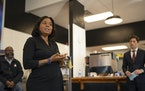 Kenya McKnight Ahad, founder of the Black Women's Wealth Alliance, spoke at the news conference with Minneapolis Mayor Jacob Frey, right. At left is