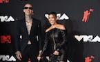 Travis Barker, left, and Kourtney Kardashian arrived at the MTV Video Music Awards at Barclays Center on Sept. 12 in New York.
