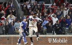 Atlanta Braves' Eddie Rosario celebrates after hitting a walk-off single to defeat the Los Angeles Dodgers 5-4.