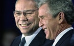 FILE - In this Dec. 16. 2000 file photo, President-elect Bush smiles as he introduces retired Gen. Colin Powell, left, as his nominee to be secretary