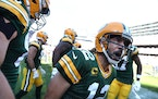 Green Bay Packers quarterback Aaron Rodgers celebrates with his teammates after rushing for a touchdown in the fourth quarter against the Chicago Bear