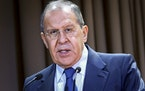In this handout photo released by the Russian Foreign Ministry Press Service, Russian Foreign Minister Sergey Lavrov speaks on the side of the meeting
