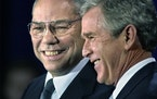 In this Dec. 16. 2000 file photo, President-elect Bush smiles as he introduces retired Gen. Colin Powell, left, as his nominee to be secretary of stat