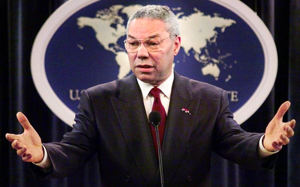 Then-Secretary of State Colin Powell talks with reporters during a news conference at the State Department of State in Washington in 2001.