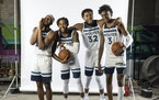 Timberwolves Josh Okogie (20), D'Angelo Russell (0), Karl-Anthony Towns (32) and Jaden McDaniels joked around during a group photo at the team's m