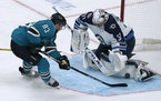 Jets goaltender Connor Hellebuyck stopped a shot by the Sharks' Matt Nieto on Saturday night in San Jose.