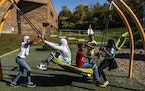 Kids played outside at St. Paul's Highwood Hills Recreation Center on Sunday, Oct. 17. The possible closure of Highwood Hills Elementary due to low