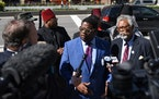 FILE - In this Sept. 6, 2017, file photo, the president of the National Action Network's Michigan Chapter, the Rev. Charles Williams II, left, and t