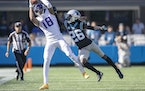 Vikings wide receiver Justin Jefferson (18) made a grab defended by Panthers cornerback Donte Jackson (26) during the fourth quarter, Sunday, October