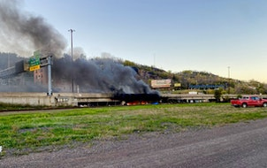 Provided by Duluth Fire Department  A fire burns underneath Interstate 35 in Duluth Monday night.