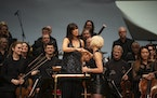 Dessa and Minnesota Orchestra conductor Sarah Hicks bumped fists at the end of the concert. JEFF WHEELER