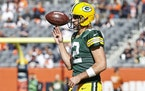 Green Bay Packers quarterback Aaron Rodgers (12) warms up prior to an NFL football game against the Chicago Bears, Sunday, Oct. 17, 2021, in Chicago.