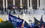 Supporters of Donald Trump clash with U.S. Capitol Police during a riot at the U.S. Capitol on Jan. 6, 2021, in Washington, D.C.