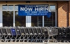 A sign advertises job openings at a Bed Bath & Beyond store in Atlanta on Oct. 13, 2021.\