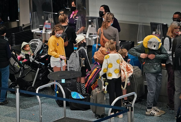 Families made their way through Terminal 1 on Tuesday at Minneapolis-St. Paul International Airport. A long weekend of teacher conferences has prompte