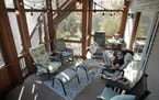Jeanie Thomas enjoyed a cup of tea and morning newspaper in the new screened-in porch at her home in Eden Prairie.