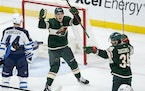 Joel Eriksson Ek (14) of the Minnesota Wild celebrated after a Mats Zuccarello (36) goal during the second period Tuesday.