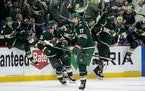 Marcus Foligno (17) celebrated as the Wild bench emptied after its overtime win over Winnipeg on Tuesday.