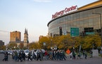 Minnesota Wild fans crossed Seventh St. ahead of the home opener at Xcel Energy Center in St. Paul on Tuesday.