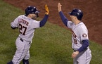 Jose Altuve and Jason Castro of the Astros celebrated after scoring against the Red Sox in the ninth inning.