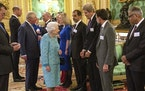 Britain's Queen Elizabeth II greets United States Special Presidential Envoy for Climate, John Kerry, third right, at a reception for the Global Inv
